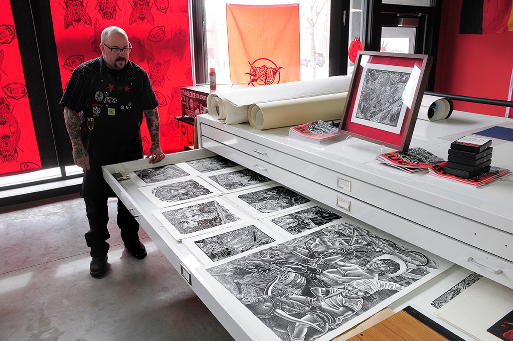 American printmaker Tom Hück with a selection of his works.