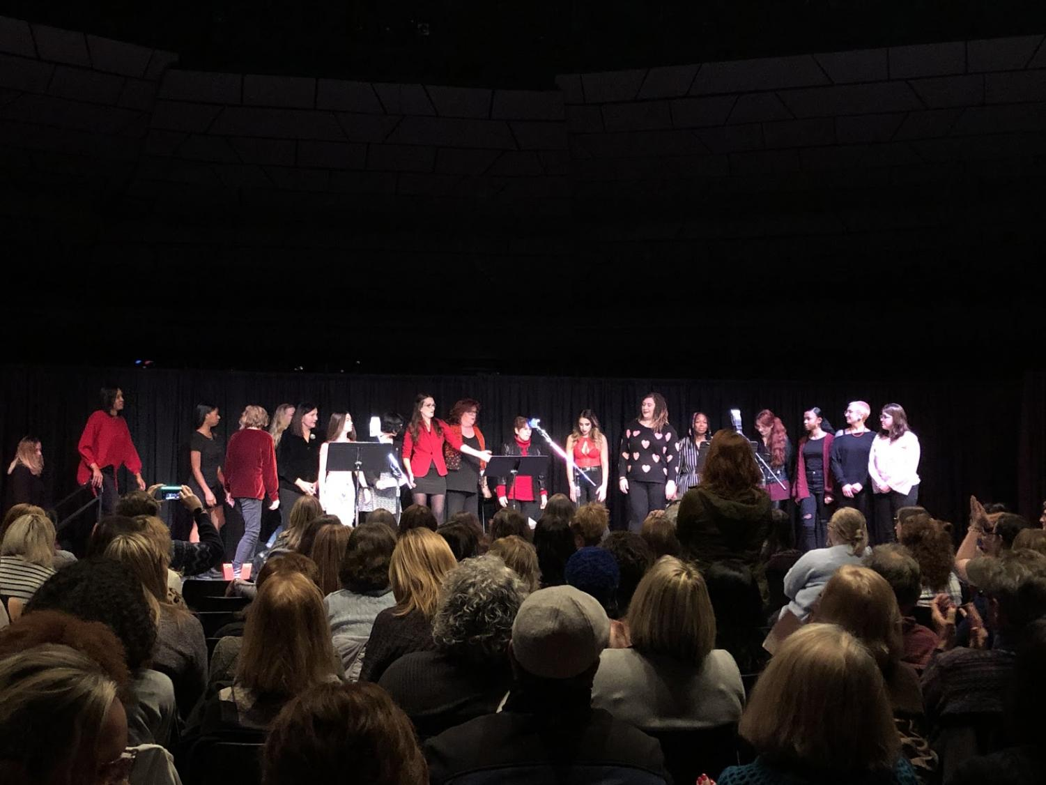 The cast of UA students, faculty and staff, as well as Akron community members, on stage.