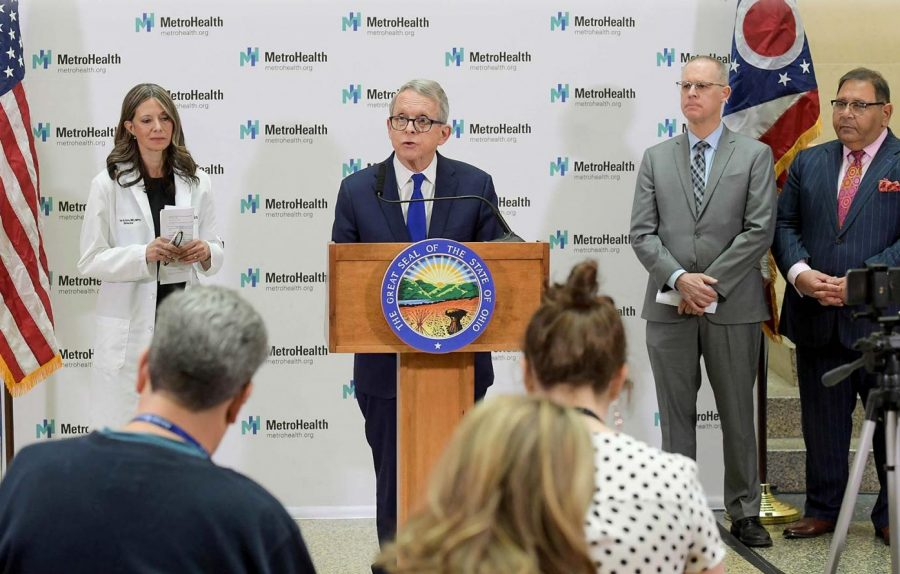 Dr. Amy Acton (left) and Ohio Gov. Mike DeWine during a previous press conference.