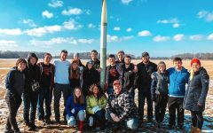 The Akronauts and their rocket in Amherst, Ohio, in February for the vehicle test launch and payload demonstration for the 2020 NASA Student Launch Competition.