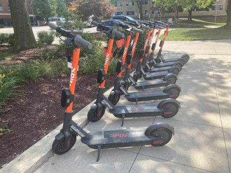 The Spin scooters available on campus and throughout downtown Akron are bright orange for easy finding.