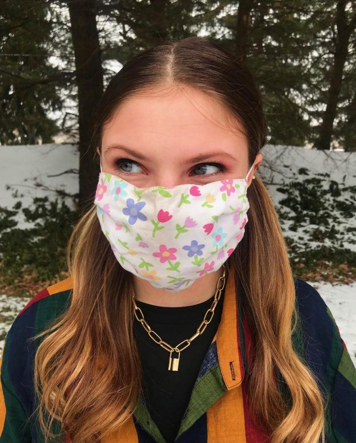 Penn Foster veterinary technology first year student, Kiley Bush, wears a spring inspired cloth face mask.